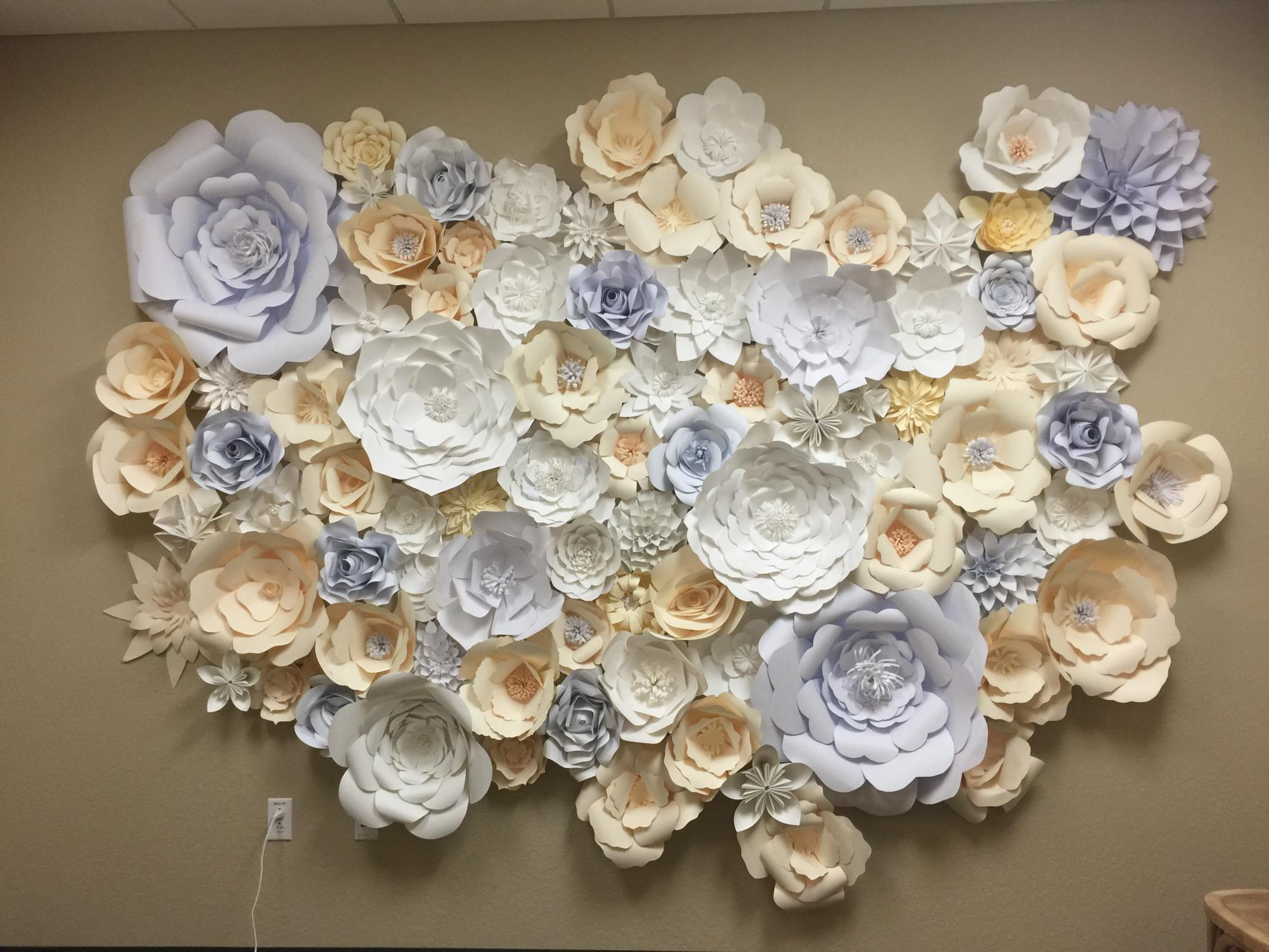 Paper flowers on a wall